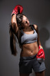 Young beautiful tired woman during fitness and boxing