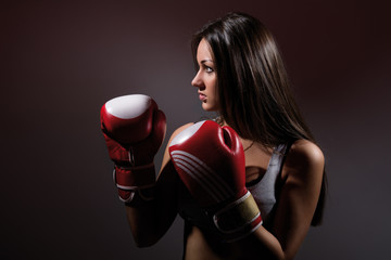 Beautiful woman with the boxing gloves