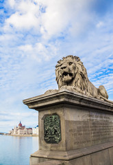 Guardian lion at the Szechenyi Chain Bridge in Budapest