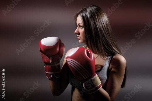 Beautiful boxing girl, fitness, on a dark background