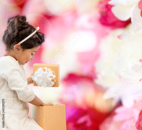 happy child girl with gift box