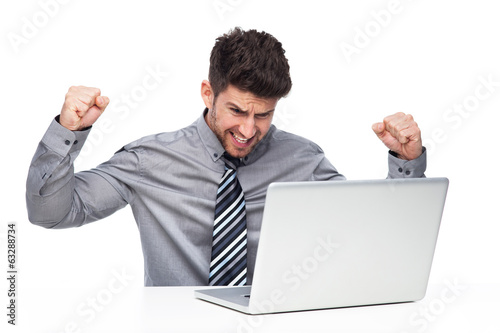 Angry man having problem with his laptop