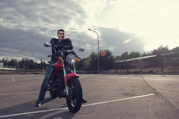 biker posing on motorbike