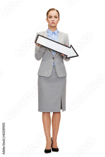 serious businesswoman with direction arrow sign