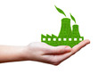 Green Nuclear power plant icon in hand