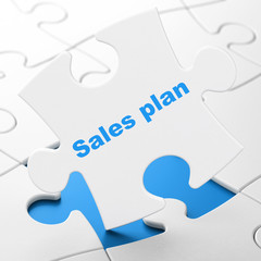 Marketing concept: Sales Plan on puzzle background
