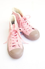 pink and brown sneakers on white background