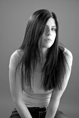 Portrait in black and white of woman with long black hair