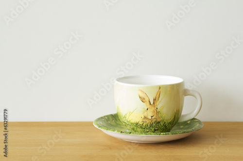 Mug/cup on wood table and white background