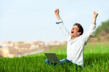 Teen shouting of joy outdoors.