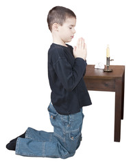 Praying boy with clipping path