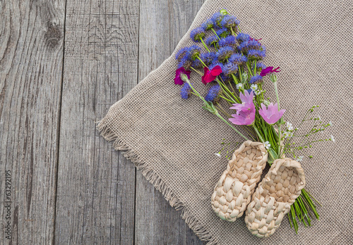 Rural still life with a bouquet of blue flowers and decorative s