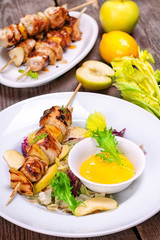Skewers of chicken fillet with apples