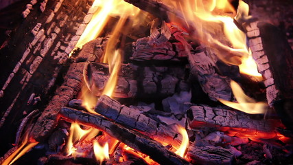 Burning log fire embers
