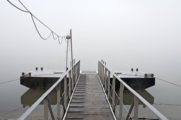 Jetty at foggy morning