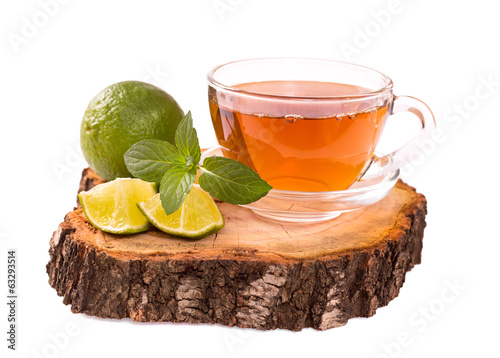 Cup of tea with lime and mint isolated on white