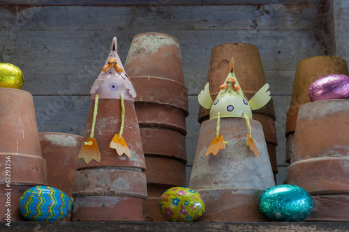 Easter egg hunt with easter chicks in garden shed