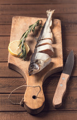 Sliced fish on cutting board