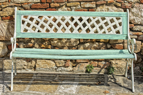 isolated bench on stone wall background