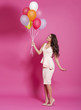 Cute young woman with balloons