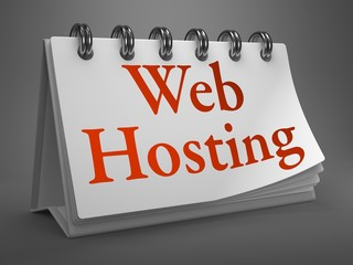 Web Hosting - Red Word on Desktop Calendar.