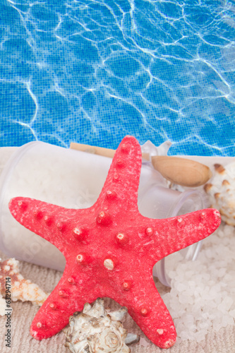 Red starfish with sea spa treatment setting