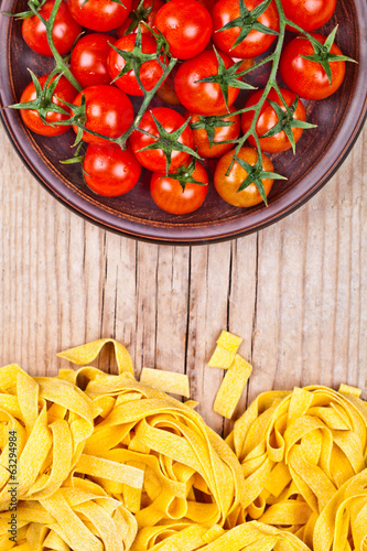 uncooked pasta and fresh tomatoes