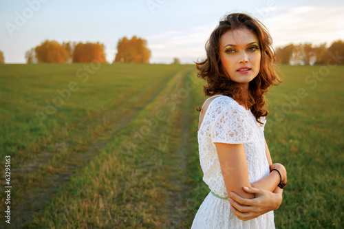 Beautiful brunette woman in field