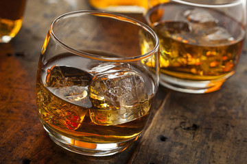 Alcoholic Whiskey Bourbon in a Glass with Ice