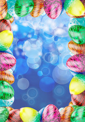 Frame with easter colored eggs on blue background