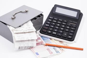 Geldkassette Rechnungen Taschenrechner