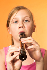 The recorder being played by a girl