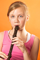 Child playing the recorder