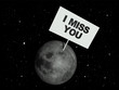 Message board on moon with the text words I Miss You