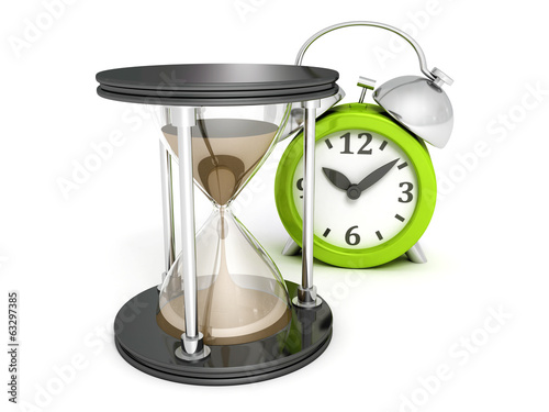 Hourglass and alarm ckock on white background