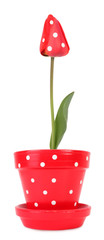 Spotted tulip in red flowerpot with white dots