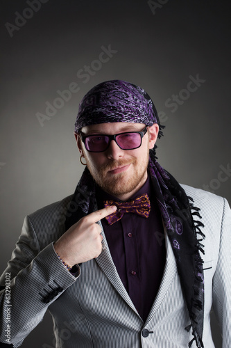 Stylish middle-aged showman posing at camera