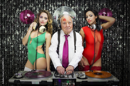 grandpa DJ and two beauitful gogo dancers - 63298525