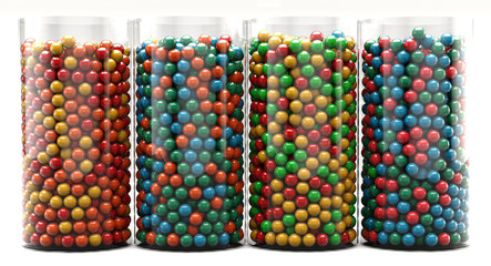 A colourful background of assorted candy in glass