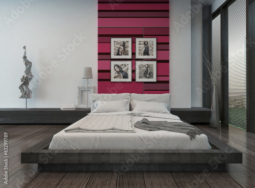 Cozy bedroom interior with pink/red colored wall