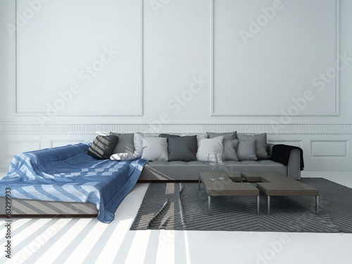 Living room interior with gray couch against white wall