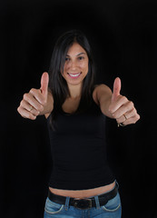 Woman with thumbs up black background