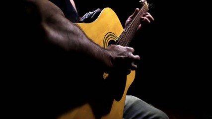 Man Playing A Solo With Acoustic Guitar.