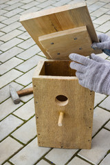 Making a birdhouse from boards spring season
