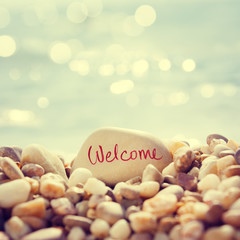 """Welcome"" Text Written on the Stone at Beach"