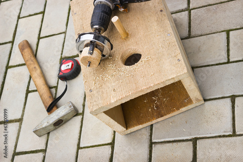 Drilling holes in the birdhouse