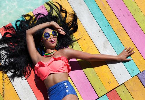Leinwanddruck Bild Tropical summer holiday woman fashion concept
