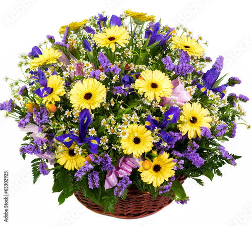 Natural gerberas and irises in a basket