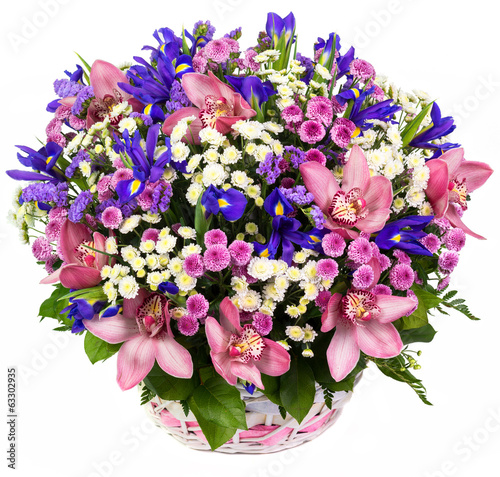 Natural orchids and irises in a basket