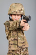 Young boy dressed like a soldier with a gun